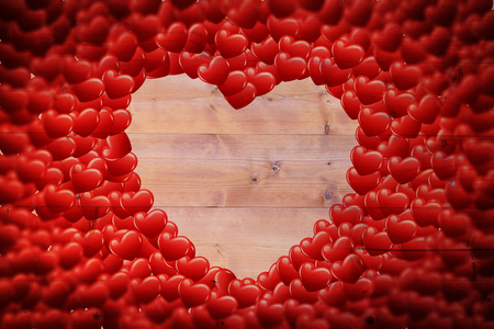 bleached: Red love hearts against bleached wooden planks background