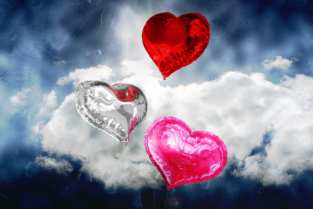 Composite image of heart balloons in the sky photo