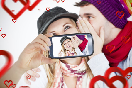convivial: Composite image of valentines couple taking a selfie
