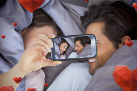hair wrapped up: Composite image of valentines couple taking a selfie
