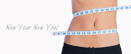 knickers: Fit belly surrounded by measuring tape on white background Stock Photo