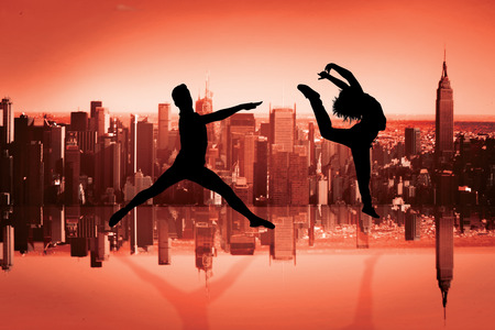 mirror image: Male ballet dancer jumping against mirror image of city skyline Stock Photo