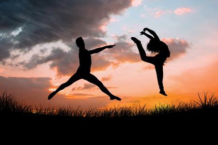 male ballet dancer: Male ballet dancer jumping against sun set