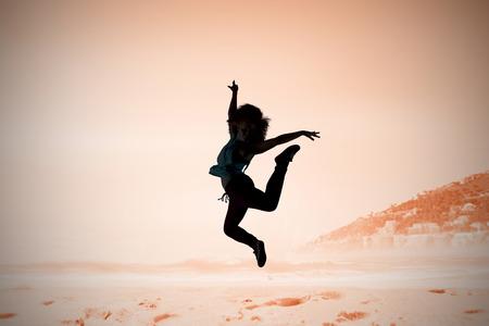 breakdancer: Pretty break dancer against beautiful beach and blue sky