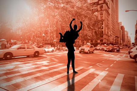 Ballerina stretching against new york street photo