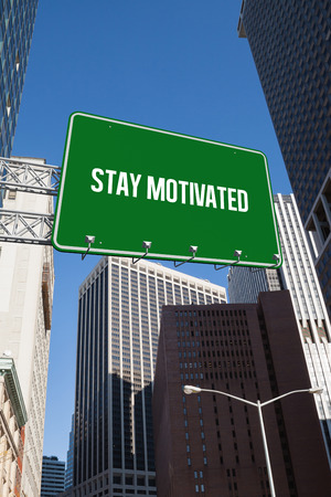 stay in the green: The word stay motivated and green billboard sign against new york