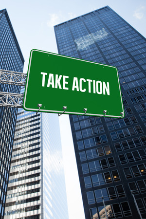 take action: The word take action and green billboard sign against low angle view of skyscrapers