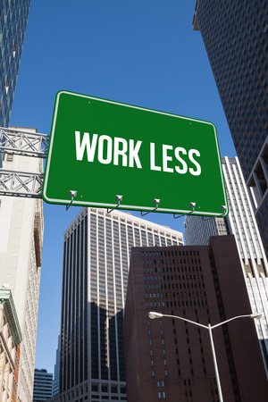 work less: The word work less and green billboard sign against new york Stock Photo