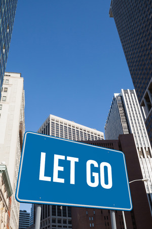 let go: The word let go and blue billboard against new york Stock Photo