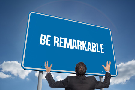 remarkable: The word be remarkable and gesturing businessman against cloudy sky with sunshine