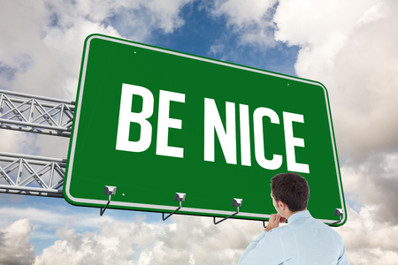 be dressed in: The word be nice and thoughtful businessman with hand on chin against blue sky with white clouds