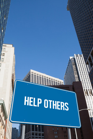 others: The word help others and blue billboard against new york