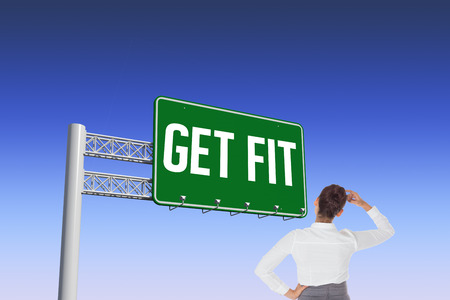get dressed: The word get fit and businesswoman scratching her head against blue and purple sky