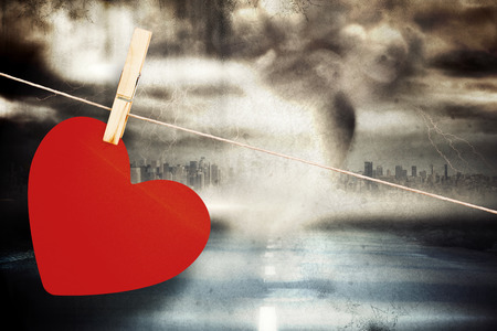 highway love: Heart hanging on line against stormy sky with tornado over road