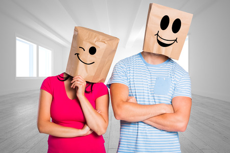 floor covering: Young couple with bags over heads against bright room with opened windows