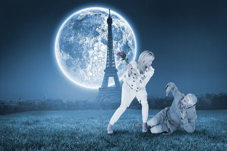 Angry woman attacking partner with rose bouquet against large moon over paris photo