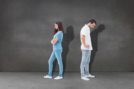 not talking: Upset couple not talking to each other after fight against grey room