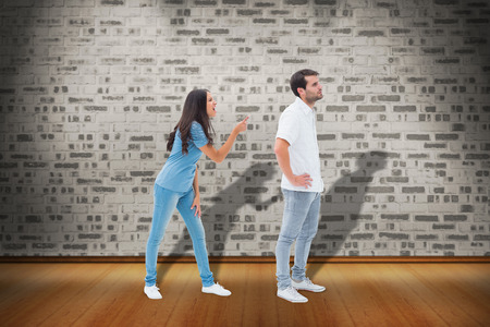 not lined: Angry brunette shouting at boyfriend against room with brick wall
