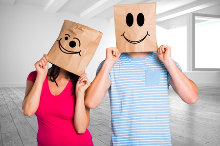 wonky: Young couple with bags over heads against white room with windows