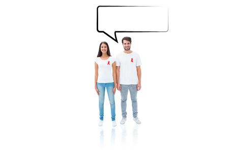 Attractive young couple wearing aids awareness ribbons against speech bubble photo