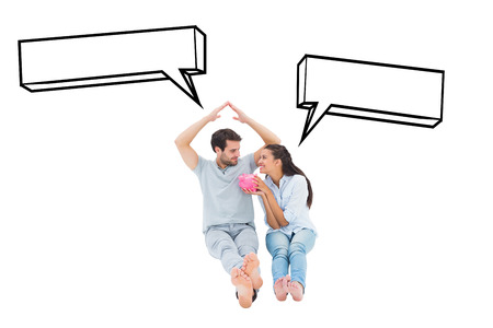considering: Cute couple considering a mortgage against speech bubble Stock Photo