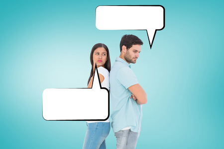 exasperated: Unhappy couple not speaking to each other  against blue vignette background Stock Photo