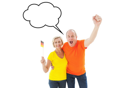 Happy german couple cheering at camera against speech bubble photo