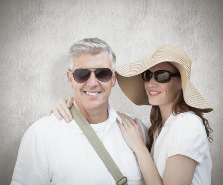 vacationing: Vacationing couple against white background