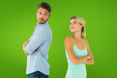Unhappy couple not speaking to each other  against green vignette photo