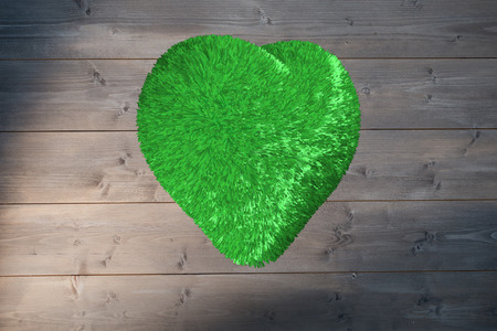 bleached: Green heart against bleached wooden planks background