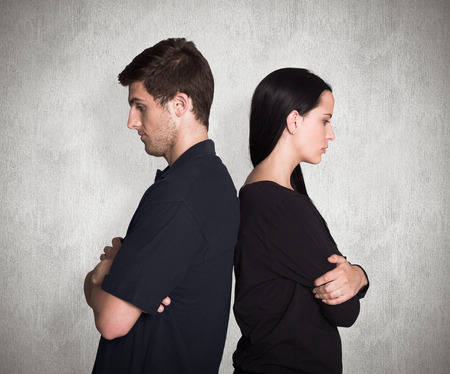 not talking: Couple not talking after argument against weathered surface Stock Photo