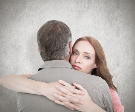 depressed woman: Casual couple hugging each other against white background