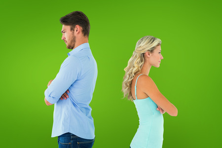exasperated: Unhappy couple not speaking to each other  against green vignette