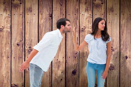 uninterested: Brunette uninterested in mans advances against wooden planks background