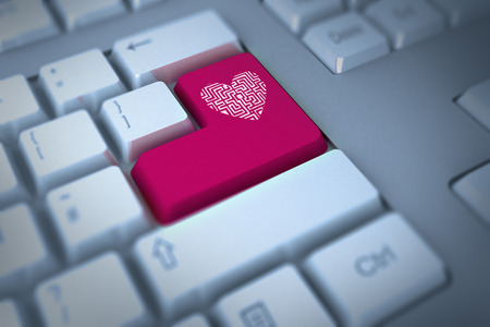 Maze heart against pink enter key on keyboard photo
