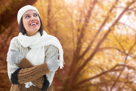 warm clothing: Brunette in warm clothing against tranquil autumn scene in forest Stock Photo