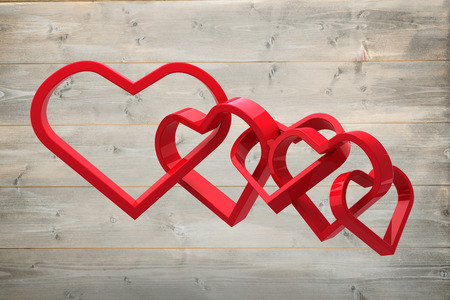 linking together: Linking hearts against bleached wooden planks background