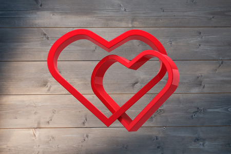 linking: Linking hearts against bleached wooden planks background