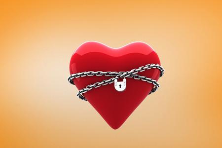 locked: Locked heart against orange vignette Stock Photo