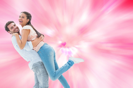girly: Attractive young couple hugging each other against digitally generated girly heart design