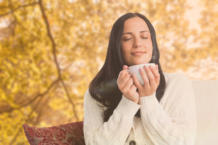 Woman enjoying a lovely drink against tranquil autumn scene in forest photo