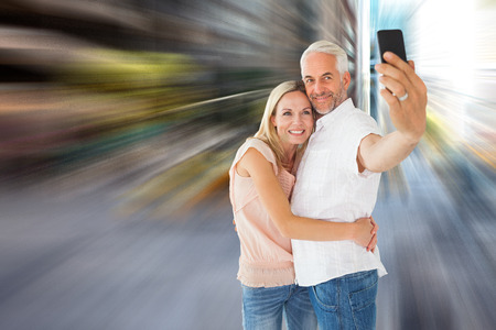 Happy couple posing for a selfie against new york street photo
