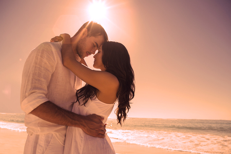 blue romance: Romantic couple embracing at the beach Stock Photo