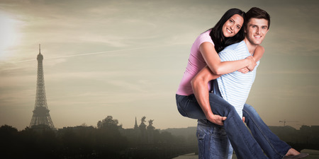 piggyback ride: Young man giving girlfriend a piggyback ride against eiffel tower