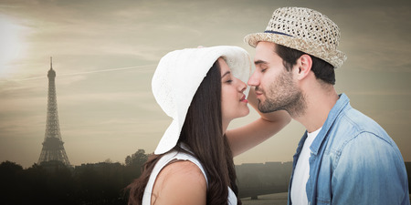 long hair boy: Happy hipster couple about to kiss against eiffel tower Stock Photo