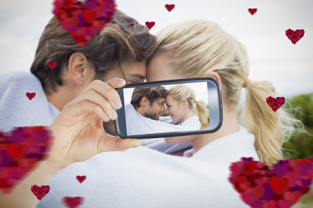 hair wrapped up: Composite of Couple taking Valentines selfie