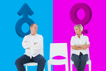 exasperated: Upset couple not talking to each other after fight against pink and blue