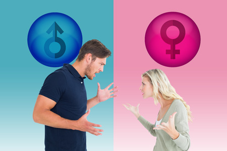 exasperated: Angry couple facing off during argument against pink and blue