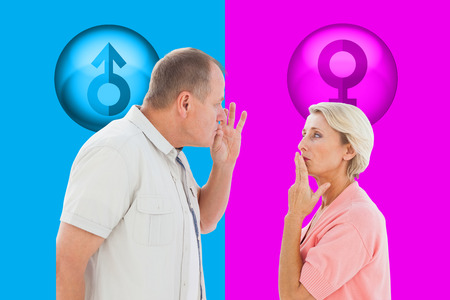 mouth couple: Older couple holding hands to mouth for silence against pink and blue Stock Photo