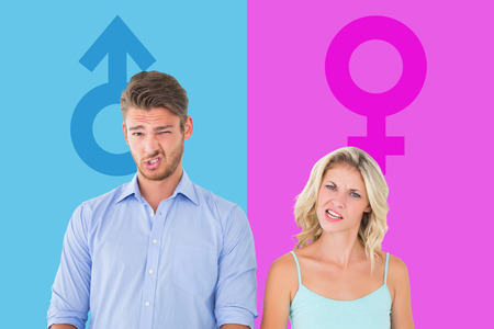 confused man: Young couple making silly faces against pink and blue